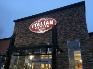 The Italian Centre Shop Sign lit up at night.