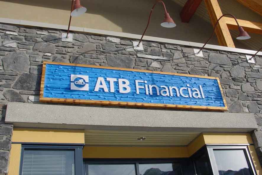 wood sign for bank company in Canmore