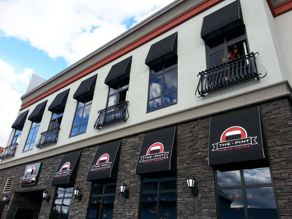 window accent awnings for a restaurant