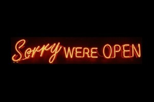 """Sorry were open"" neon sign with a spelling error"