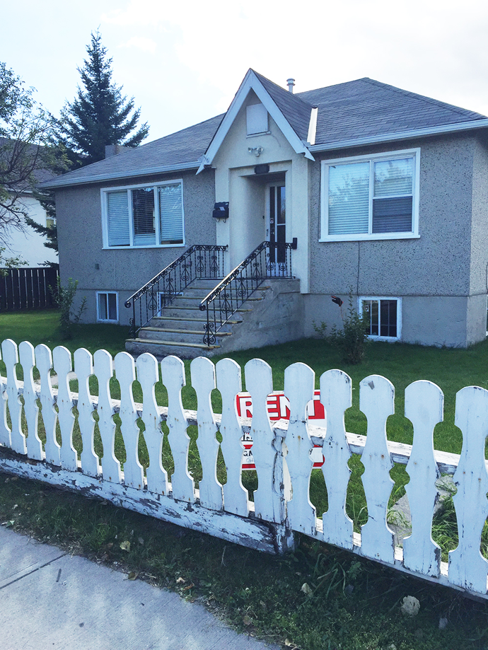 """A """"for rent"""" sign is hidden by a fence - a yard sign mistake."""