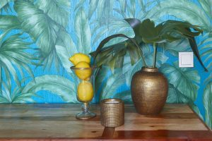 indoor decoration set with green plant lemons tropical wallpaper.